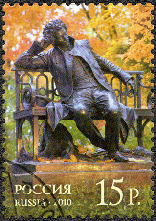 aleksander: RUSSIA - CIRCA 2010: A stamp printed in Russia shows monument in honor of the 100th anniversary of birth of Alexander Pushkin (1799-1837), by sculptor R.R. Bach, The 300th anniversary of foundation of Tsarskoe Selo, circa 2010