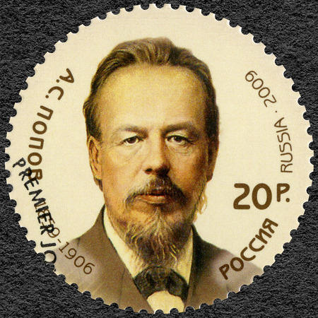 physicist: RUSSIA - CIRCA 2009: A stamp printed in Russia dedicated the 150th anniversary of the birth of Alexander Stepanovich Popov (1859-1906), physicist, electrical engineer and inventor of radio, circa 2009