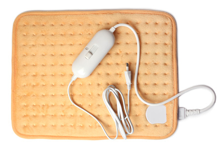 Electric heating pad on white background