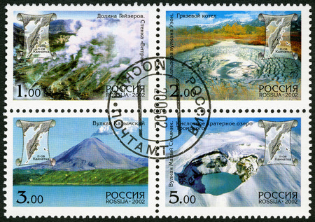 crater lake: RUSSIA - CIRCA 2002: A stamp printed in Russia shows acidic crater lake, Troitsky Crater, Maly Semyachik Volcano, Valley of Geysers, series Kamchatka Peninsula Volcanos, circa 2002