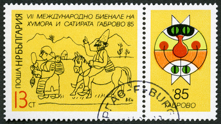 satire: BULGARIA - CIRCA 1985: A stamp printed in Bulgaria shows se-tenant with label picturing Gabrovo Cat emblem, dedicated 7th International Humor and Satire Biennial, circa 1985