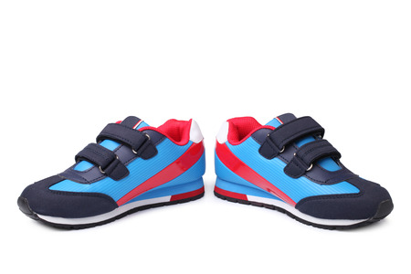 Baby sport shoes pair on white background 스톡 콘텐츠