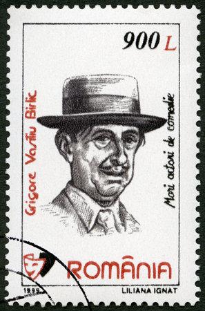 postage: ROMANIA - CIRCA 1999: A stamp printed in Romania shows portrait of Grigore Vasiliu Birlic (1905-1970), series Comic Actors, circa 1999