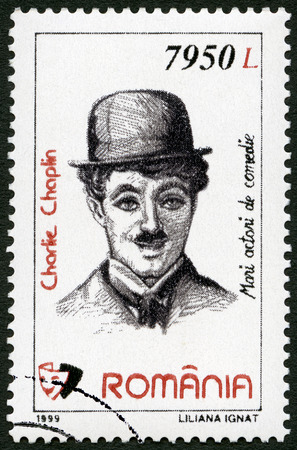 rumania: ROMANIA - CIRCA 1999: A stamp printed in Romania shows portrait of Charlie Chaplin (1889-1977), series Comic Actors, circa 1999