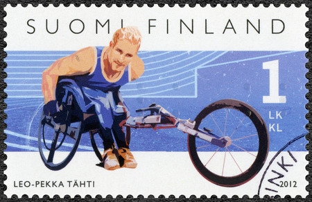 paralympic: FINLAND - CIRCA 2012: A stamp printed in Finland shows Finnish Champions in disabled sports, wheelchair racer Leo-Pekka Tahti, series Summer Paralympic Games, circa 2012