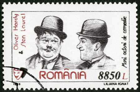 hardy: ROMANIA - CIRCA 1999: A stamp printed in Romania shows Oliver Hardy (1892-1957) and Stan Laurel (1890-1965), series Comic Actors, circa 1999