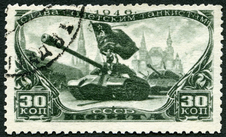 honoring: USSR - CIRCA 1946: A stamp printed in USSR shows Tank Divisions in Red Square, series Honoring Soviet tankmen, circa 1946
