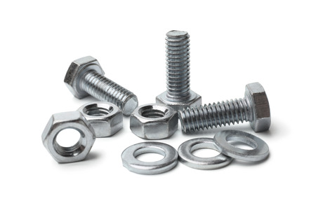 Steel bolts and nuts on white background Stockfoto