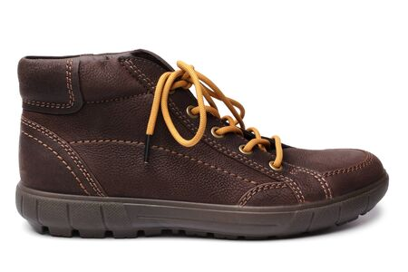 shoestrings: Leather brown boot on white background