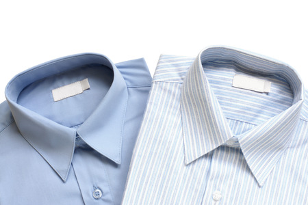 drycleaning: Dress shirts isolated on white background Stock Photo
