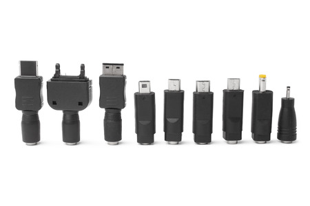 adapters: Different adapters for charger on white background Stock Photo