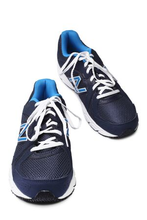 balance: ST. PETERSBURG, RUSSIA - March 31, 2014: New Balance Athletic Shoes on white background