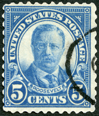 theodore roosevelt: UNITED STATES OF AMERICA - CIRCA 1920: A stamp printed in USA shows portrait of President Theodore Roosevelt (1858-1919), 26th President of USA, circa 1920 Editorial