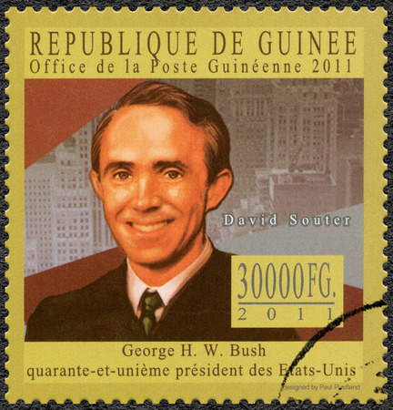 GUINEA - CIRCA 2011: A stamp printed in Republic of Guinea shows David Hackett Souter (1934-2012), Associate Justice of the Supreme Court of the United States, series George H. W. Bush forty-first President of the United States, circa 2011 Editorial