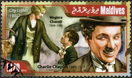 chaplin: MALDIVES - CIRCA 2014: A stamp printed in Maldives shows portrait of Charlie Chaplin (1889-1977) and Virginia Cherrill (1908-1996), film City Lights, 1931, circa 2014