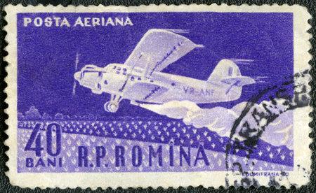 rumania: ROMANIA - CIRCA 1960: A stamp printed in Romania shows Amphibian ambulance plane, series 50th anniv. of the first Romanian airplane flight by Aurel Vlaicu, circa 1960