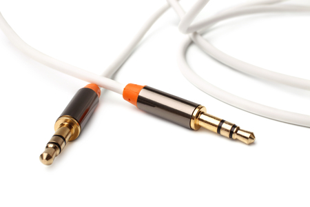 minijack: Auxiliary audio stereo cable cord male to male 3,5mm universal gold on white background