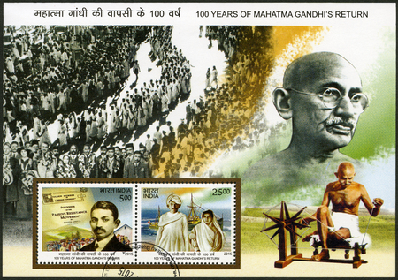 nonviolent: INDIA - CIRCA 2015: A stamp printed in India shows portrait of Mohandas Karamchand Gandhi (1869-1948), anniversary 100 years of Mahatma Gandhi return, circa 2015