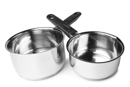stainless steel background: Stainless steel milk pans on white background Stock Photo