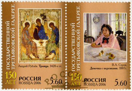 trinity: RUSSIA - CIRCA 2006: A stamp printed in Russia shows Trinity, by Andrei Rublev 1420 and Girl with Peaches, by V. A. Serov, 1887, series 150th anniversary of Tretyakov Gallery, circa 2006