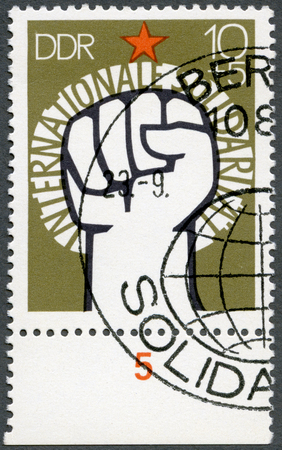 gdr: GERMAN DEMOCRATIC REPUBLIC - CIRCA 1973: A stamp printed in GDR Germany shows Raised Fist and Star, devoted Surtax was for the Solidarity Committee of the German Democratic Republic, circa 1973 Editorial