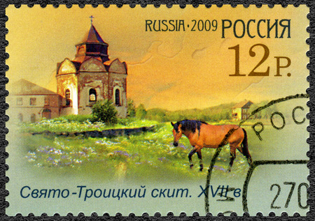 send to prison: RUSSIA - CIRCA 2009: A stamp printed in Russia shows Sviato-Troitsky skit, series the worldwide cultural heritage in Russia. Historical - cultural complex in Solovetsky islands, circa 2009 Editorial
