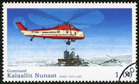 est: GREENLAND - CIRCA 2013: A stamp printed in Greenland shows helicopter Sikorsky H-34 S-58 est (1973-1982), series Aviation III, circa 2013 Editorial
