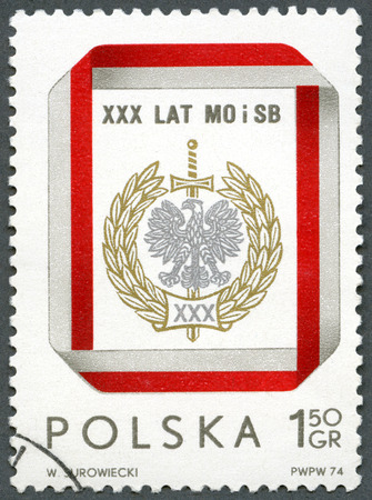 polish: POLAND - CIRCA 1974: A stamp printed in Poland shows Civic Militia and Security Service Badge, devoted  30th anniversary, circa 1974