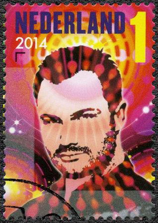 jeffrey: NETHERLANDS - CIRCA 2014: A stamp printed in Netherlands shows Jeffrey Sutorius from music project Dash Berlin, series Dutch DJ, circa 2014