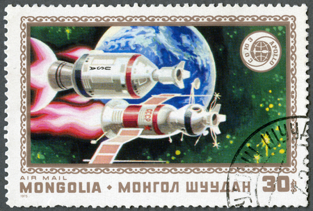 soyuz: MONGOLIA - CIRCA 1975: A stamp printed in Mongolia shows Apollo, Soyuz and Earth, series Russo- American space cooperation, launching July15, link-up July 17, circa 1975 Editorial