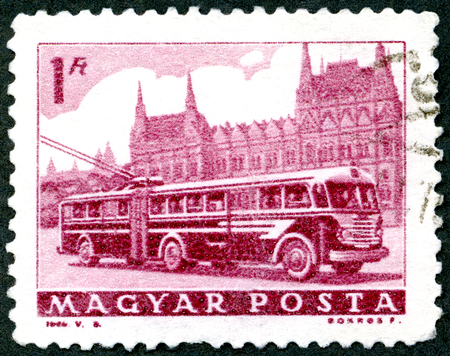 publicize: HUNGARY - CIRCA 1963: A stamp printed in Hungary shows Bus and Parliament, circa 1963