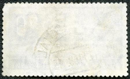 unstuck: Blank postage stamp block souvenir sheet on a black background
