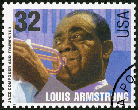 louis armstrong: UNITED STATES OF AMERICA - CIRCA 1995: A stamp printed in USA shows Louis Armstrong Satchmo Pops (1901-1971), jazz composer and trumpeter, circa 1995