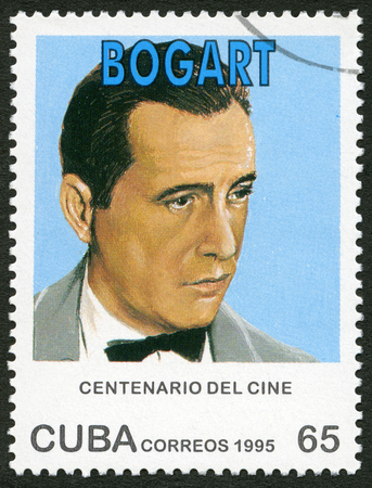 postage: CUBA - CIRCA 1995: A stamp printed in Cuba shows Humphrey DeForest Bogart (1899-1957), series Century Motion Pictures, circa 1995 Editorial