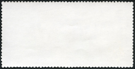 blanked: Blank postage stamp sheet on a black background Stock Photo