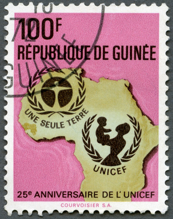 unicef: GUINEA - CIRCA 1971: A stamp printed in Republic of Guinea shows UNICEF Emblem, Map of Africa, series 25th anniversary, circa 1971