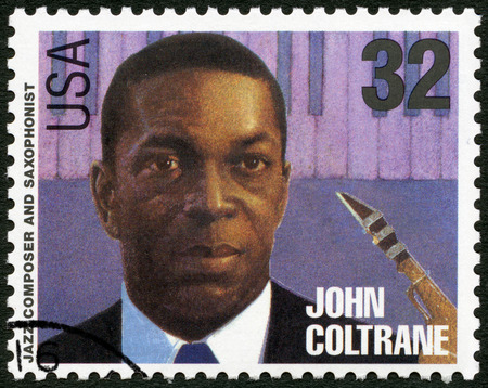 john: UNITED STATES OF AMERICA - CIRCA 1995: A stamp printed in USA shows John William Coltrane (1926-1967), jazz composer and saxophonist, circa 1995 Editorial