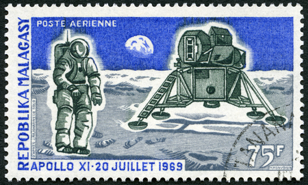 module: MALAGASY REPUBLIC - CIRCA 1969: A stamp printed in Malagasy (Madagascar) shows Apollo 11 Lunar Landing Module and Man on the Moon, first anniversary of mans first landing on the moon, circa 1969