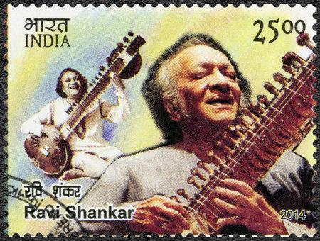 shankar: INDIA - CIRCA 2014: A stamp printed in India shows portrait of Ravi Shankar Robindro Shaunkor Chowdhury (1920-2012), circa 2014