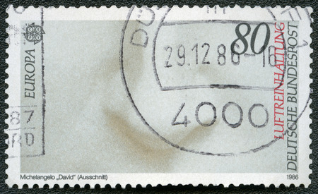 printmaker: GERMANY - CIRCA 1986: A stamp printed in Germany shows Details from Michelangelo David, circa 1986 Editorial