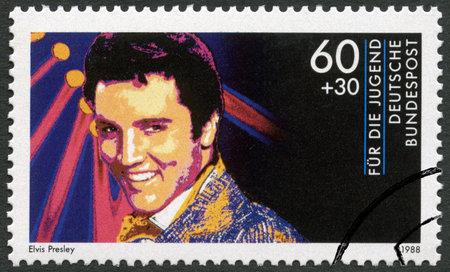 elvis presley: GERMANY - CIRCA 1988: A stamp printed in Germany shows Elvis Presley (1935-1977), series Rock Stars, circa 1988
