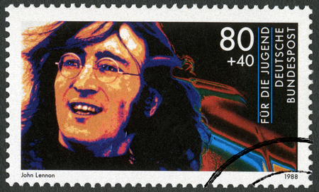 john lennon: GERMANY - CIRCA 1988: A stamp printed in Germany shows John Winston Ono Lennon (1940-1980), series Rock Stars, circa 1988