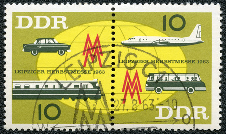 publicize: GERMAN DEMOCRATIC REPUBLIC - CIRCA 1963: A stamp printed in GDR Germany shows Globe, plane and bus, car and train,Issued to publicize the 1963 Leipzig Fall Fair, circa 1963 Editorial