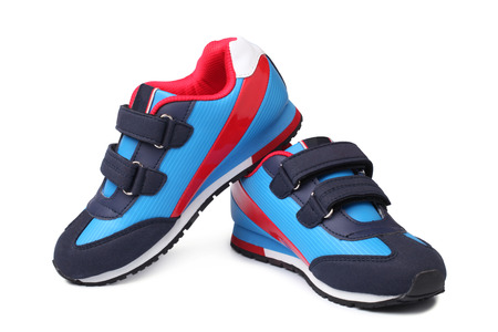 Baby sport shoes pair on white background Zdjęcie Seryjne