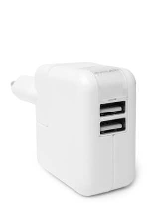 over voltage: Electrical adapter to USB ports on white background