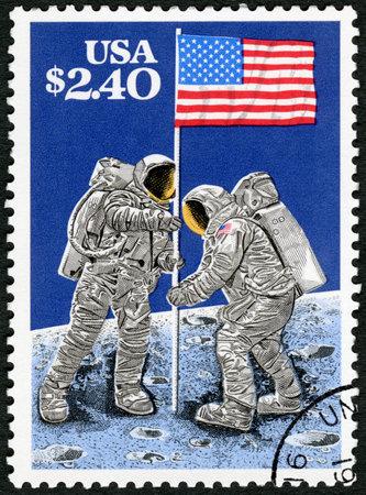 USA - CIRCA 1989: A stamp printed in USA shows Raising Flag on Lunar Surface, July 20, 1969, Moon Landing, 20th Anniversary, circa 1989