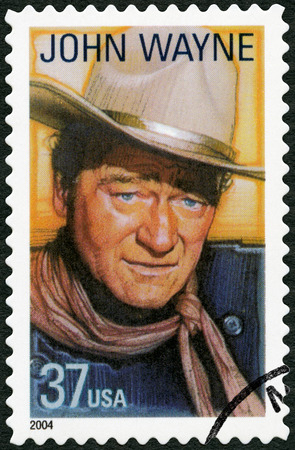 john wayne: UNITED STATES OF AMERICA - CIRCA 2004: A stamp printed in USA shows Marion Mitchell Morrison John Wayne (1907-1979), series Legends of Hollywood, circa 2004