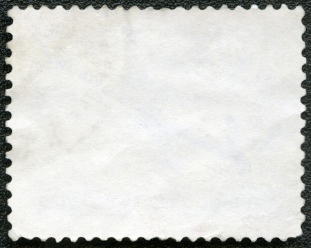 blanked: Blank postage stamp on a black background Stock Photo