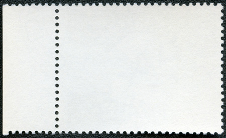unstuck: Blank postage stamp sheet on a black background Stock Photo