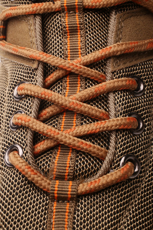 lace up: Closeup view of hiking boot, a vertical picture